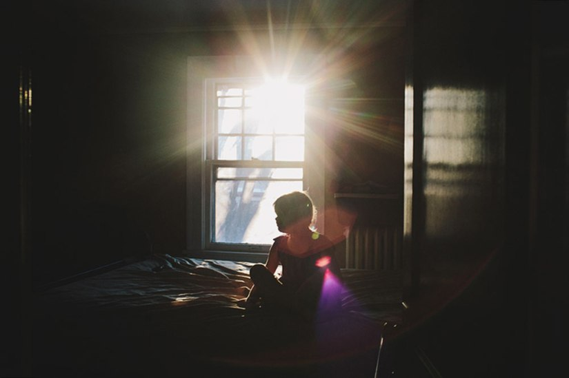photographer-sarah-swansons-image-of-girl-in-purple-dress-inside-room-with-sun-shining-through-window.jpg